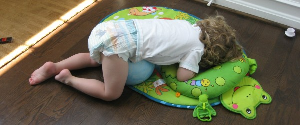 child asleep on floor