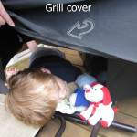 child asleep under grill