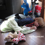 boy asleep with toys