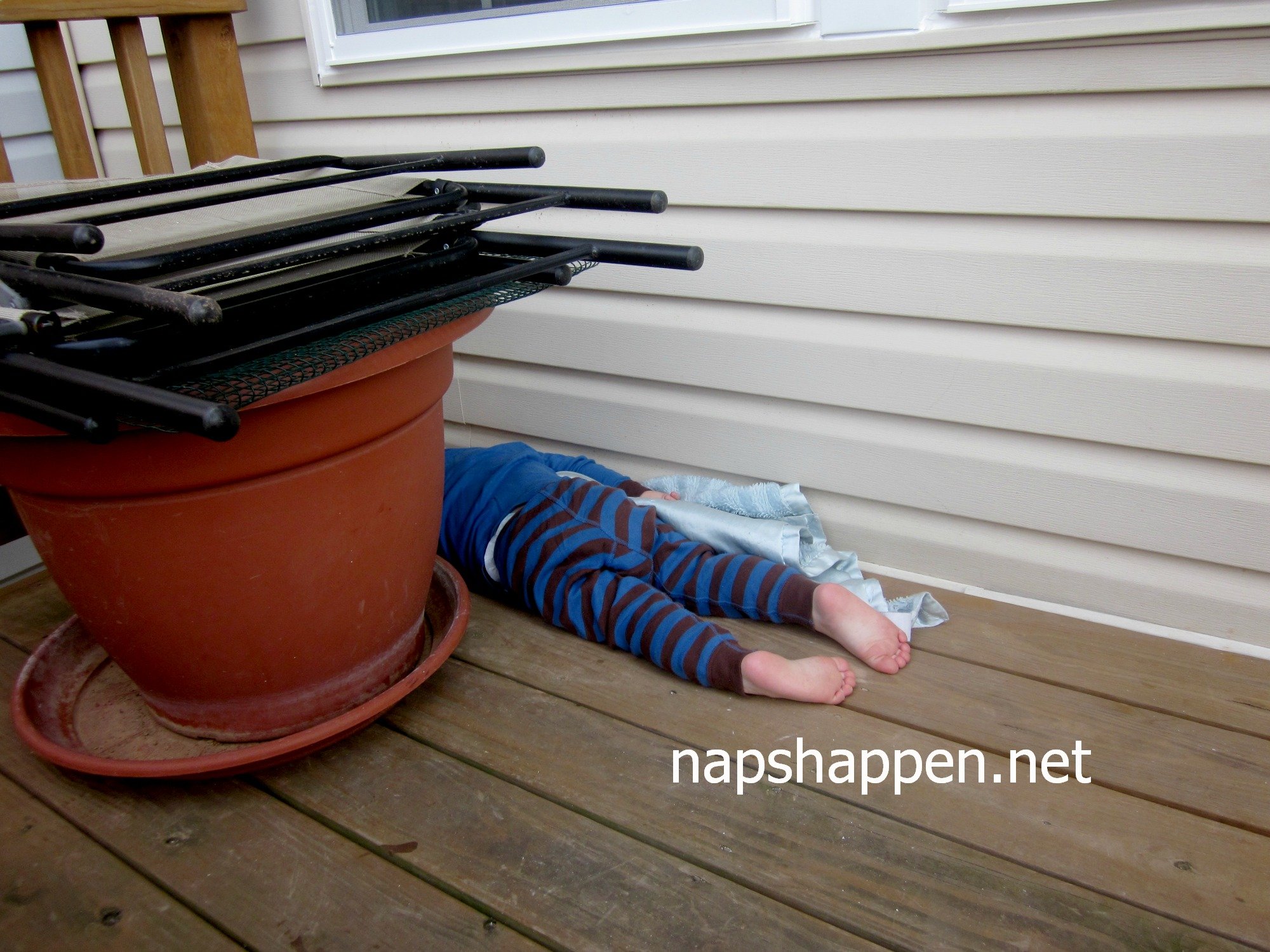 child asleep on deck planks