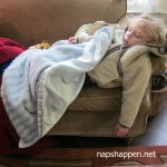 child napping on couch