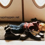 child asleep on shoes