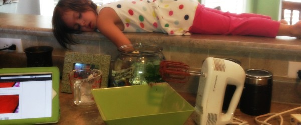 child sleeping on counter
