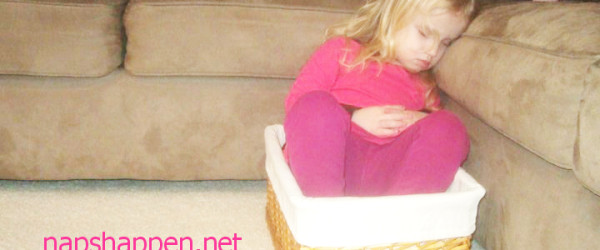 girl asleep in basket