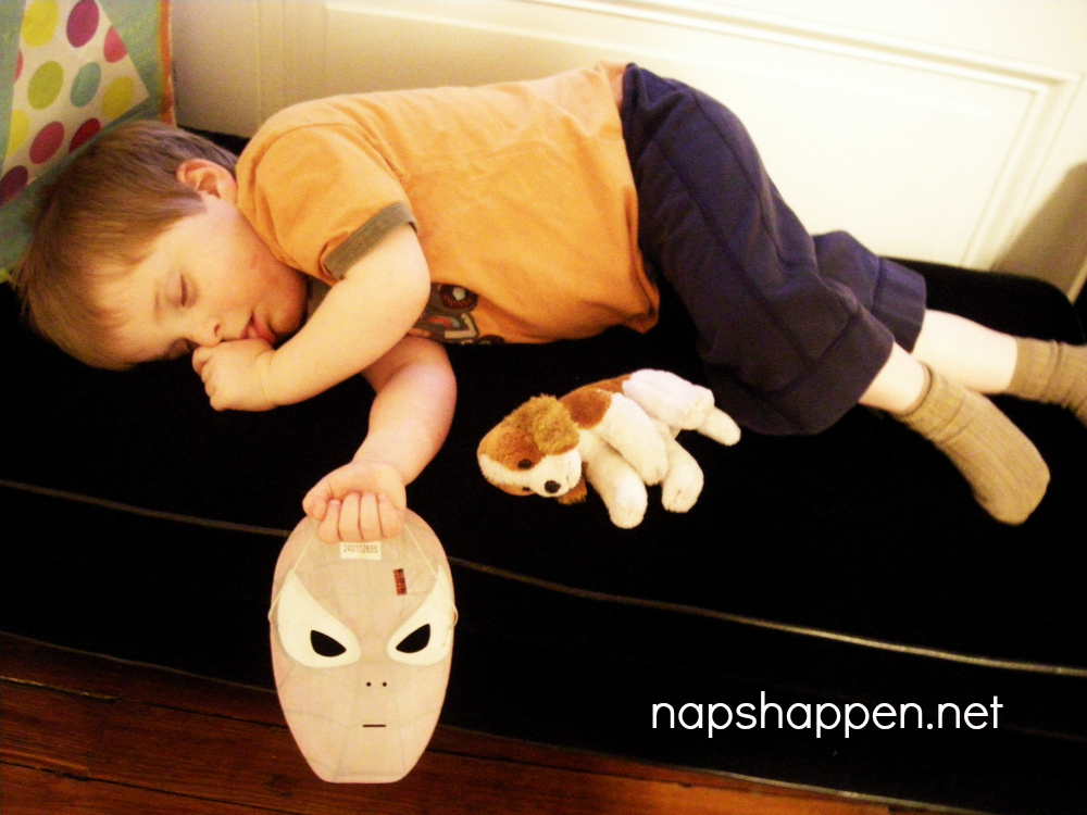 child asleep with mask