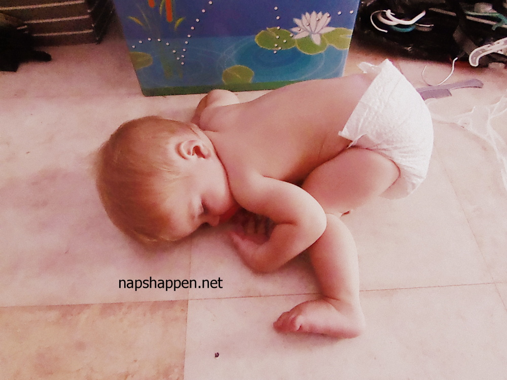 baby asleep on floor