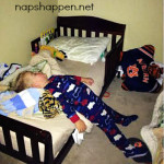 child asleep in footies