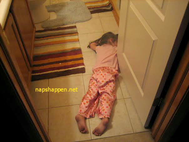 child asleep on tile